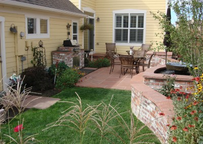 Flagstone Patio, Brick Wall, Ornamental Bed Spaces, Water Feature, Outdoor Room, Custom Brick Outdoor Kitchen