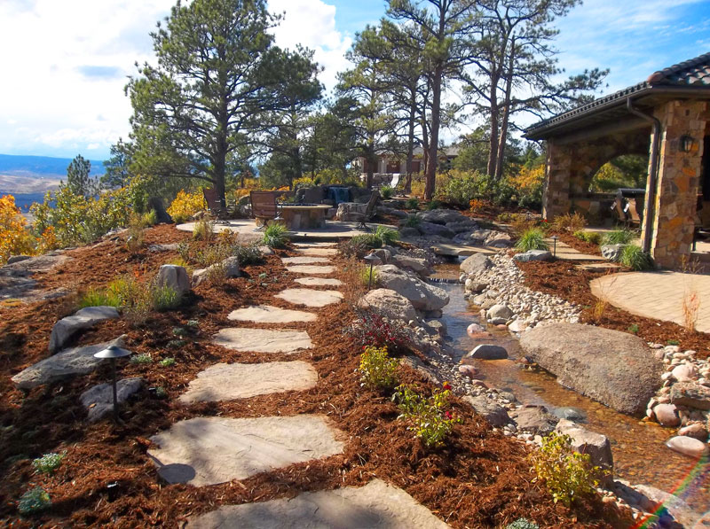Flagstone Pathway, Ornamental Planting Bed, Custom Water Feature, Colorado Themed Design