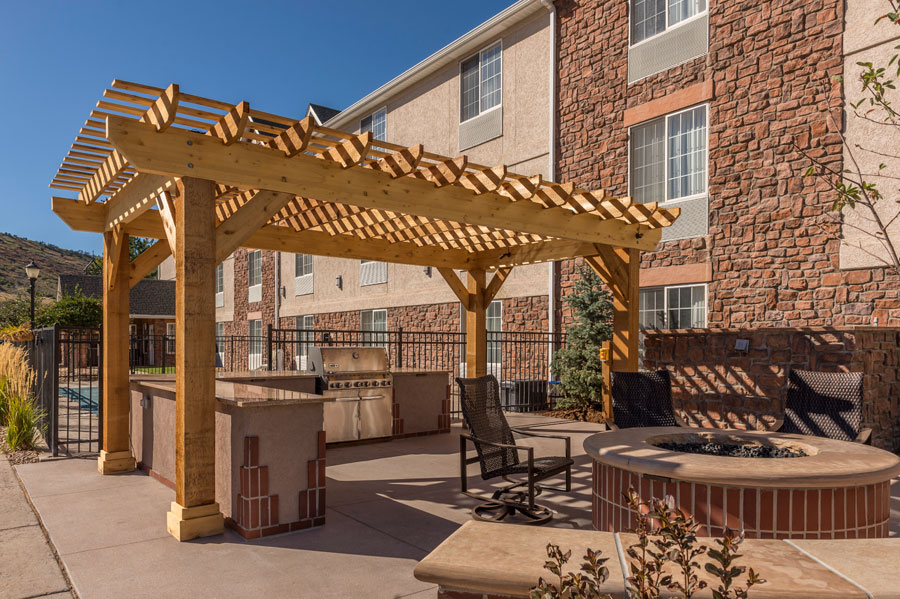 Outdoor Room, Fire Pit, Outdoor Kitchen, Pergola, Stained Concrete Patio