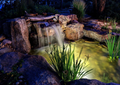 waterfall into pond night