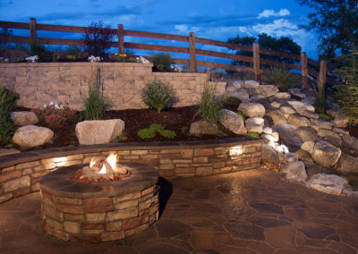 Beautiful Backyard Fire Pit and Seat Wall