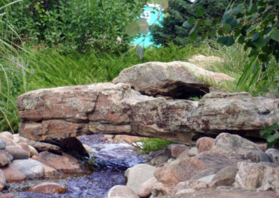 rock bridge over water feature